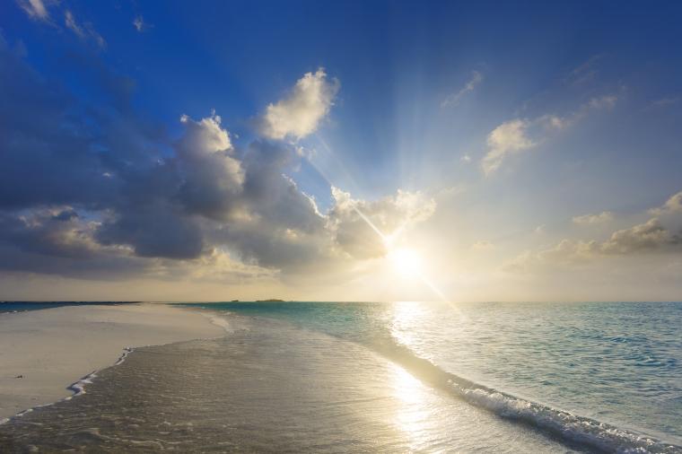 Tropical sunset near the island beach at Maldives